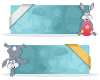 Easter Banners with Happy Bunny Rabbit. Two blue Easter banners with a cute cartoon bunny rabbit character smiling and greeting, Easter elements and a ribbon Royalty Free Stock Image