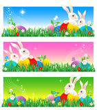 Easter banners or poster. Easter banners with bunnies, colorful eggs, green grass, flowers and copy space, or use entire image as poster background Stock Photo