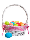 Easter Basket. An Easter Basket full of freshly dyed eggs. Shot on white background Stock Images