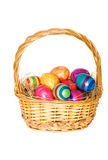 Easter basket. With painted eggs on white background Royalty Free Stock Image