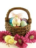 Easter Basket. With toy bunny and baby chick on white background Stock Images