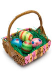 Easter Basket. Wooden basket full of Easter eggs. Isolated on a white background Stock Images