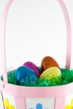 Easter Basket. Filled with artificial grass and plastic eggs stock image