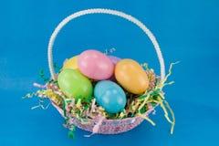 Easter basket. A filled easter basket with plastic eggs stock image