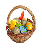 Easter basket. Easter eggs and decorations in a wicker basket Royalty Free Stock Photography