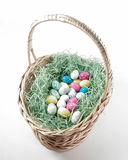 Easter Basket. An Easter basket filled with fake grass an candy eggs Stock Photography