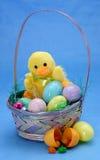 Easter Basket. Seasonal concept: easter basket on blue Royalty Free Stock Photos