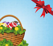 Easter Basket on a blue background Royalty Free Stock Photos