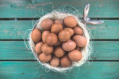 Easter basket / bowl with eggs stock image