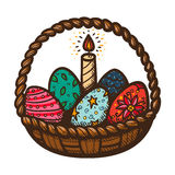 Easter basket with candle and eggs. Stock Photography