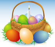 Easter basket with candle Stock Photo