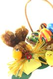 Easter Basket with chick, eggs and bunny. On a light background Stock Photos