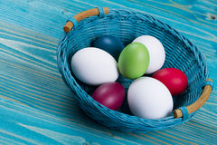 Easter basket with color eggs Royalty Free Stock Photo