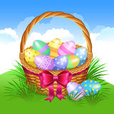 Easter basket with color painted easter eggs. Easter eggs Stock Photography