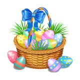 Easter basket with color painted easter eggs  on white Stock Image