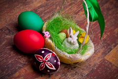 Easter Basket And Colored Eggs Stock Image