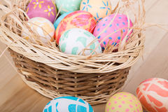 Easter Basket of Colored Eggs Stock Photos