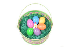 Easter basket with colored eggs and hen Royalty Free Stock Photography