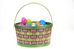 Easter basket with colored eggs and hen Royalty Free Stock Photos