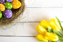 Easter basket with colored eggs royalty free stock photography