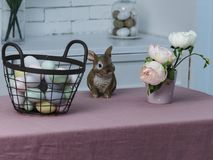 Easter basket with colored eggs and rabbit and flowers royalty free stock photo