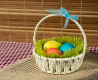 Easter basket with colored eggs stock photography
