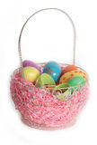 Easter Basket with Colorful Easter Eggs Stock Images