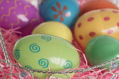 Easter Basket with Colorful Easter Eggs Stock Photos