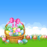 Easter basket and colorful Easter eggs in green grass Stock Images