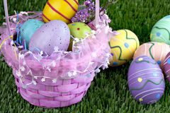 Easter basket and colorful eggs Royalty Free Stock Images