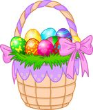 Easter Basket with colorful eggs Stock Photos