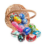 Easter basket with colorful eggs. Basket with traditional hand painted Easter Eggs Stock Photography
