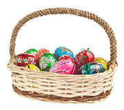 Easter basket with colorful eggs. Easter basket full of wooden pisanky's Royalty Free Stock Photography