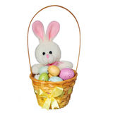 Easter basket with colorful eggs and bunny toy isolated Royalty Free Stock Photos