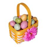 Easter basket with colorful eggs isolated Royalty Free Stock Images