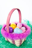 Easter basket wih colorful eggs. An Easter basket with colorful eggs sitting on fake green grass Stock Images