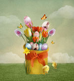 Easter basket. Easter composition with easter eggs and chicks Stock Photo