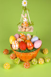 Easter basket and a cradle. Easter basket and Easter egg with rabbit in a cradle Royalty Free Stock Photo