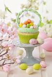 Easter basket cupcake stock photo