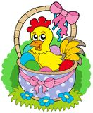 Easter basket with cute chicken Stock Images
