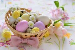 Easter basket festive arrangement on a table suface Stock Photo