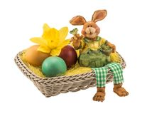 Easter basket with decorative clay bunny and eggs royalty free stock images