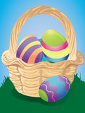 Easter basket with dyed eggs Stock Photo