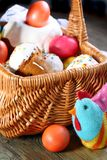 Easter basket with Easter cakes and eggs. Stock Photos
