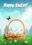 Easter basket with Easter eggs on a field, realistic Easter card Stock Photo