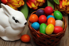 Easter basket with Easter eggs. Easter basket with Easter eggs and flowers royalty free stock photo