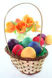 Easter basket with Easter eggs and tulips Stock Images