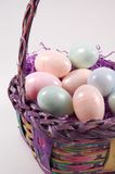 Easter Basket with Easter Eggs - Verticle View. Verticle view of an Easter Basket filled with Easter grass and plastic Easter Eggs Stock Photo