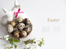Easter basket with easter eggs on white background. Easter eggs in easter basket on white background Royalty Free Stock Images