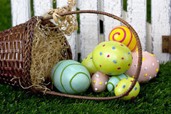 Easter basket and eggs Stock Photos
